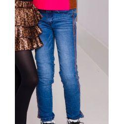 Jeans en denim bleu avec bandes latérales en paillettes